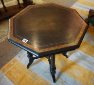 A Victorian Ebonised and Amboyna Octagonal Table, Aesthetic period, Having a label to the