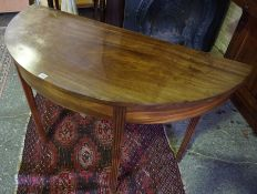 A Mahogany Demi Lune Table, Raised on reeded tapered legs, 72cm high, 126cm wide, 55cm deep