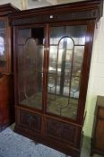 A Mahogany Cabinet by Hobbs of London, circa late 19th century, Having two glazed astragal doors,