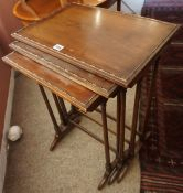 A Mahogany Nest of Three Tables, Having three graduated tables, 67cm high, 49cm wide