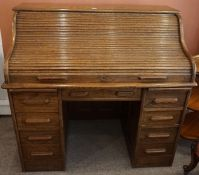 An Oak Roll Top Desk, circa early 20th century, Having a tambour shutter enclosing a fitted