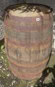 A Large Wooden and Metal Bound Barrel for Bourbon, 92cm high, 55cm diameter