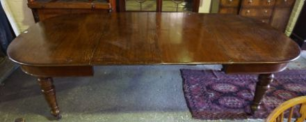 Oak Extending Dining Table, circa early 20th century, Having two additional leaves, raised on