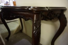 A Victorian Style Mahogany Serpentine Hall / Side Table, Raised on cabriole legs with scroll feet,
