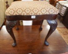 A Mahogany Dressing Stool, Having a fabric covered top, raised on cabriole legs with pad foot,