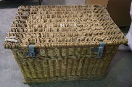 A Large Wicker Laundry Basket, circa late 19th century, with locking bar and lock, lined interior,