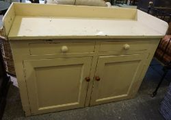 A Victorian Painted Pine Dresser, Having a three quarter gallery top, above two small drawers and