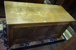 A Vintage Oak Coffer, Having a hinged top, and a carved front, 61cm high, 122cm wide, 53cm deep