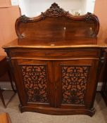 A Victorian Rosewood Chiffonier, Having a carved pediment, above a large drawer and two cupboard