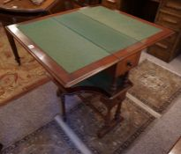 A Late Victorian Mahogany Card Table, circa 1900, Having a green felt lined interior, with drawers