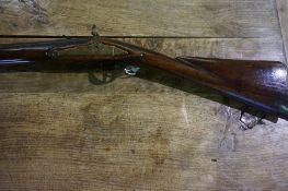 A Single Barrel Flintlock Sporting Gun, circa 19th century, Having a full walnut stock, engraved