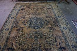 A Persian Design Carpet, Decorated with allover floral panels, on a pink ground, 356cm x 244cm