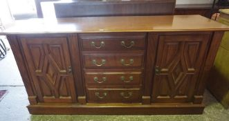 A Victorian Style Mahogany Sideboard, Having four graduated drawers to the centre, flanked with a