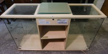 A Floor Standing Glass Display Case, Having a drawer above open shelving, flanked with a glazed end,