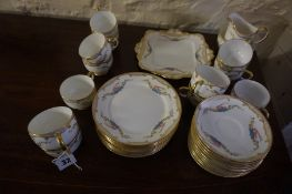 A Twelve Piece Paragon FIne Bone China Tea Set, Decorated with floral panels on a white ground, with