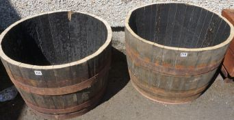 A Pair of Wooden and Metal Bound Half Barrels, 45cm high, 65cm wide, (2)