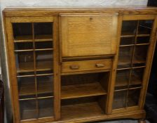 An Oak Secretaire Display Cabinet, circa 1930s, Having a fall front enclosing pigeon holes,