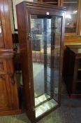 A Mahogany Shop Display Cabinet, circa early 20th century, Having a glazed door, lacking shelves,