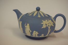 A Wedgwood Jasperware Blue and White Tea Pot, 13cm high, also with a large Denby stoneware jug,