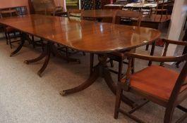 A Regency Style Mahogany Triple Pillar Dining Table, Having three additional leaves, raised on