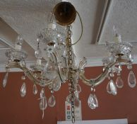 A Venetian Style Glass Chandelier, Having six branches with suspended glass pear shaped drops,
