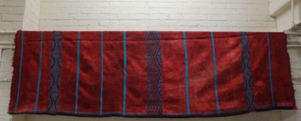 A Moroccan Throw, Decorated with blue geometric and plain bands, on a red ground, approximately