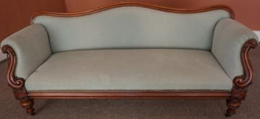 A Victorian Mahogany Sofa, Upholstered in later pale green fabric, raised on turned feet to the