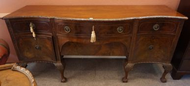 A Chippendale Style Mahogany Serpentine Sideboard, circa early 20th century, Having a large drawer
