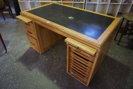 A Vintage Golden Oak Desk, Having two slides to the top, above three garduated drawers, flanked with