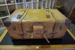 A Vintage Travel Trunk, Having brass and leather fittings, with a hinged top enclosing a canvas