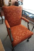 A Pair of Chippendale Style Mahogany Armchairs, Upholstered in red floral damask, raised on ball and