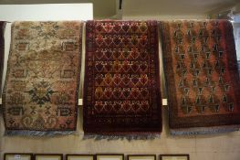 Five Assorted Small Persian Rugs / Prayer Mats, All having geometric design on various coloured