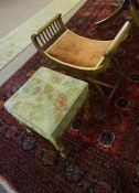 A Victorian Walnut Stool, having a needlepoint top, raised on turned legs, 45cm high, 36cm wide,