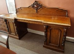 A Victorian Scottish Mahogany Pedestal Sideboard, Having a carved pediment, decorated with scrolls