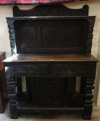 A William and Mary Style Oak Court Cupboard, Decorated with carved diamond shaped lozenges, and mask