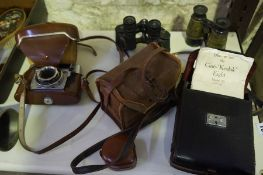 A Mixed Lot of Vintage Cameras and Field Glasses, To include a Kodak cine camera, model 20, in