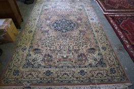 A Persian Design Carpet, Decorated with a large floral medallion to the centre, within panels of