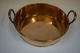 A Copper Cream Pan, circa 19th century, 11cm high, 44cm wide