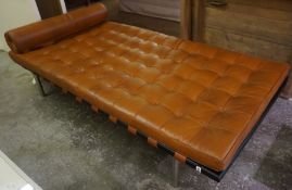 A Retro Style Day Bed, Having a tan coloured button back seat, with a matching rolled cushion, 196cm