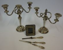 Two Silver Handled Dressing Items, 19cm, 21cm long, also with two silver plated candleabra, and a