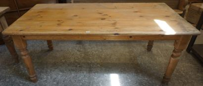 A Pine Refectory Table, Having a rectangular plank top, raised on turned legs, 74cm high, 184cm