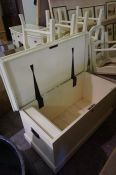 A Painted Blanket Box, Having a hinged top, with metal carry handles, raised on castors, 51cm