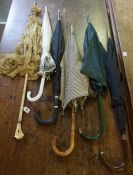 Six Assorted Parasols / Umbrellas, circa early 20th century and later, to include a lace example