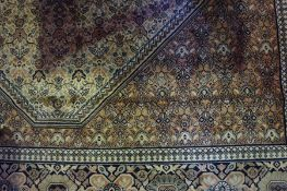 A Large Persian Style Machine Made Carpet, Having allover floral medallions, on a pink ground, 420cm