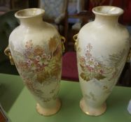 A Pair of Royal Bonn Vases, Decorated with applied floral panels on a blush ivory ground, 35cm high,