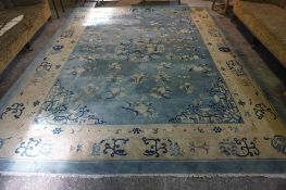 A Large Chinese Carpet, circa 1920s, Decorated with allover floral panels and Chinese symbols, on