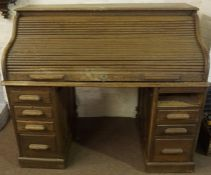 A Lebus Oak Roll Top Desk, circa 1930s, Having a tambour shutter enclosing a fitted interior, raised