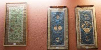 A Pair of Chinese Style Silk Panels, Decorated with embroidered floral panels on a blue ground, 63cm