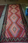 An Antique Iranian Kelim Rug, Decorated with multiple geometric panels, on a multi coloured