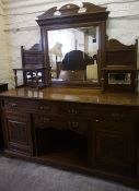 A Late Victorian Oak Mirror Back Sideboard, The mirrored section is raised on turned pilasters,